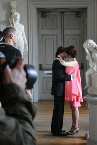 A man and a woman kiss amongst some sculptures