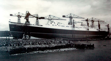 archive photo of crowds watching the launch of a huge ship