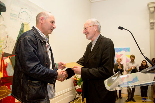 Artist Michael Simpson (right), receives the £25,000 first prize from juror Ansel Krut.