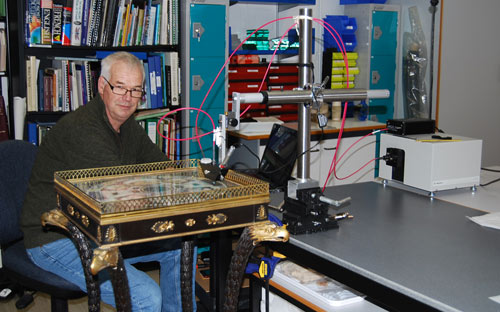 Man with technical equipment and a decorative table