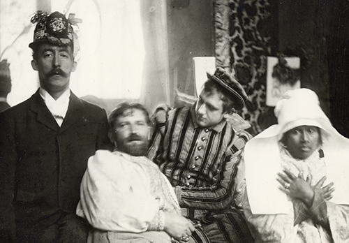 Alphonse Mucha (second from left) and friends in his studio in Paris.