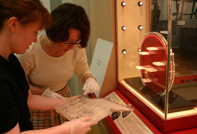 2 women installing a museum display