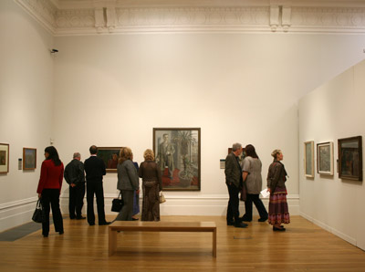 People looking at painting