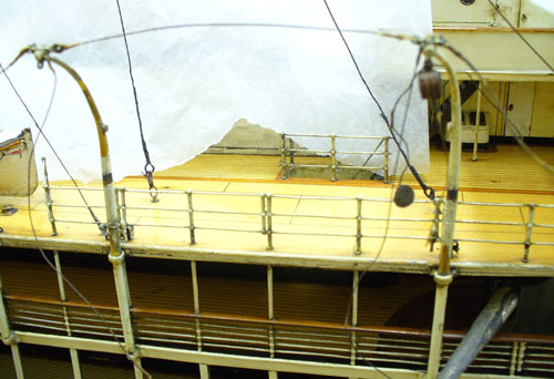 detail of empty davits on the deck of a model ship