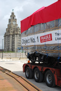 overhead railway carriage on the back of a lorry at the Pier Head by the Museum of Liverpool