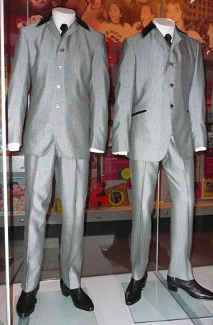 two grey Beatles suits displayed on mannequins