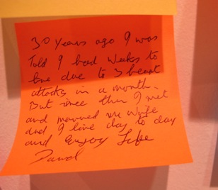 An orange post-it note left by a visitor to the Rankin exhibtion expressing emotion