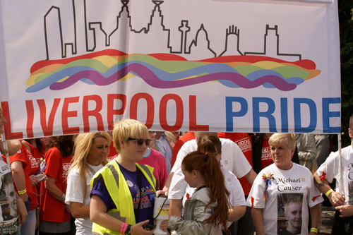 people under a large Liverpool Pride banner