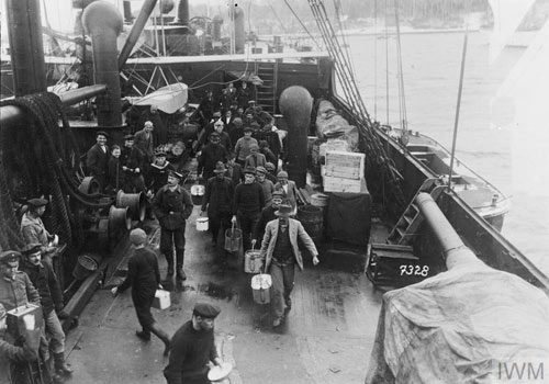 men on the deck of a ship