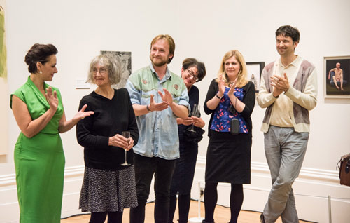 Artists clapping at a private view