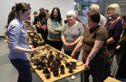 Visitors learning about finds from Rainford