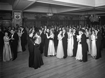old photo of smartly dressed couples dancing in a large hall