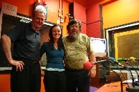 three people posing together in a radio studio