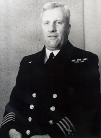 Black and white photo of a man in naval uniform