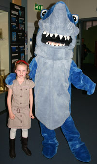 Big furry shark with a little girl