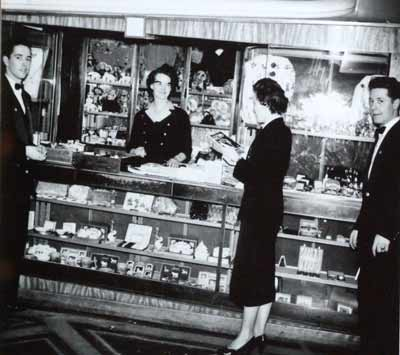 Black and white photo of people in a shop