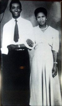 Photo of man and woman arm in arm