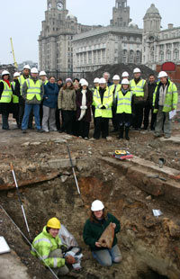 People around hole on building site
