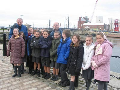 group of schoolchildren at docks