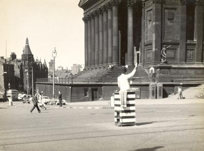 policeman directing traffic on Lime Street