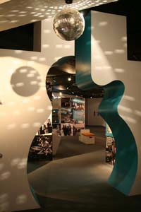 A ginat cut-out of a guitar forms an archway in TBGO