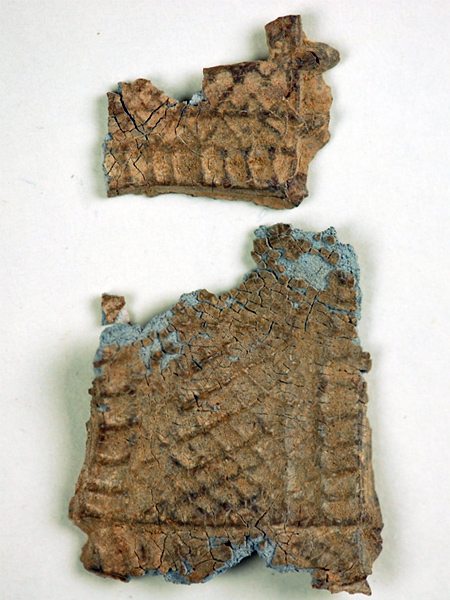 Two main fragments of a decorative plaque