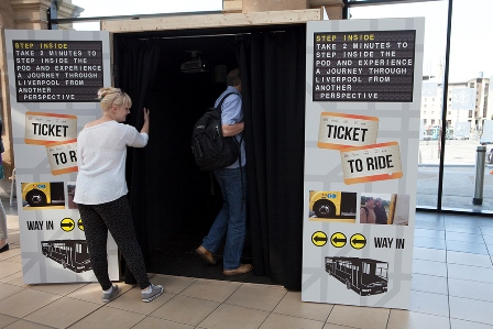 Visitors immerse themselves in the Ticket to Ride display.