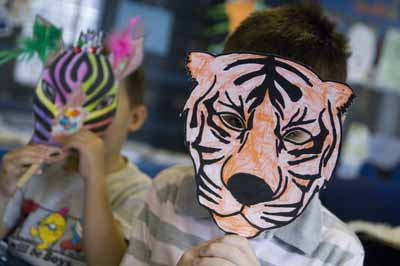 Child with tiger mask