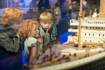 Children looking at ship model