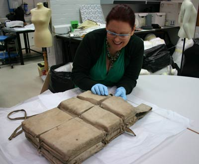 conservator Anne-Marie Hughes examining the Titanic lifejacket