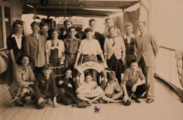 old group photo of boys on the deck of a ship