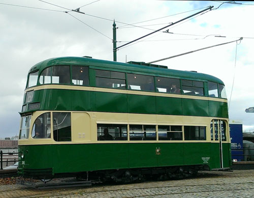 historic tram running on a tramline in Birkenhead