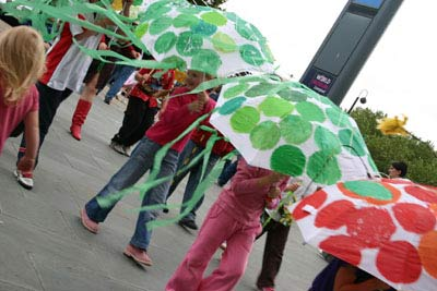 children parading with colourful, decorated umbrellas