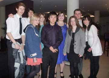 Group of nine youth volunteers at awards ceremony in London