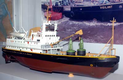 photo of a modern ship model with two green buoys on the deck