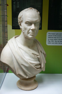 White marble bust of a man's head and shoulders