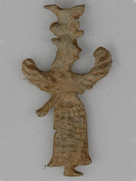 A winged female figure votive offering