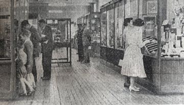 Black and white photo of interior of museum