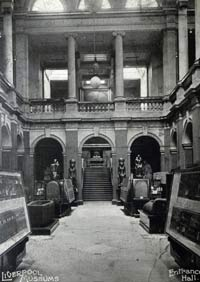 Black and white photo of old museum interior.
