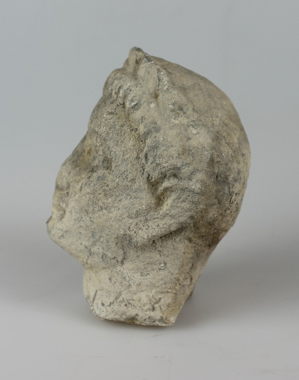 Head from a votive statue card