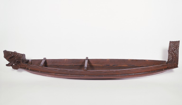 Model of a war canoe (waka taua) card