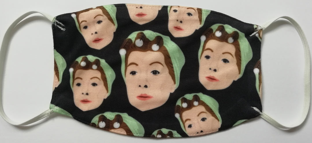 facemask with repeated pattern of Hilda Ogden's head, wearing rollers and a headscarf