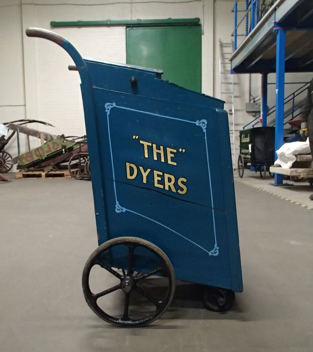 handcart with 'The Dyers' in gold letters on the side