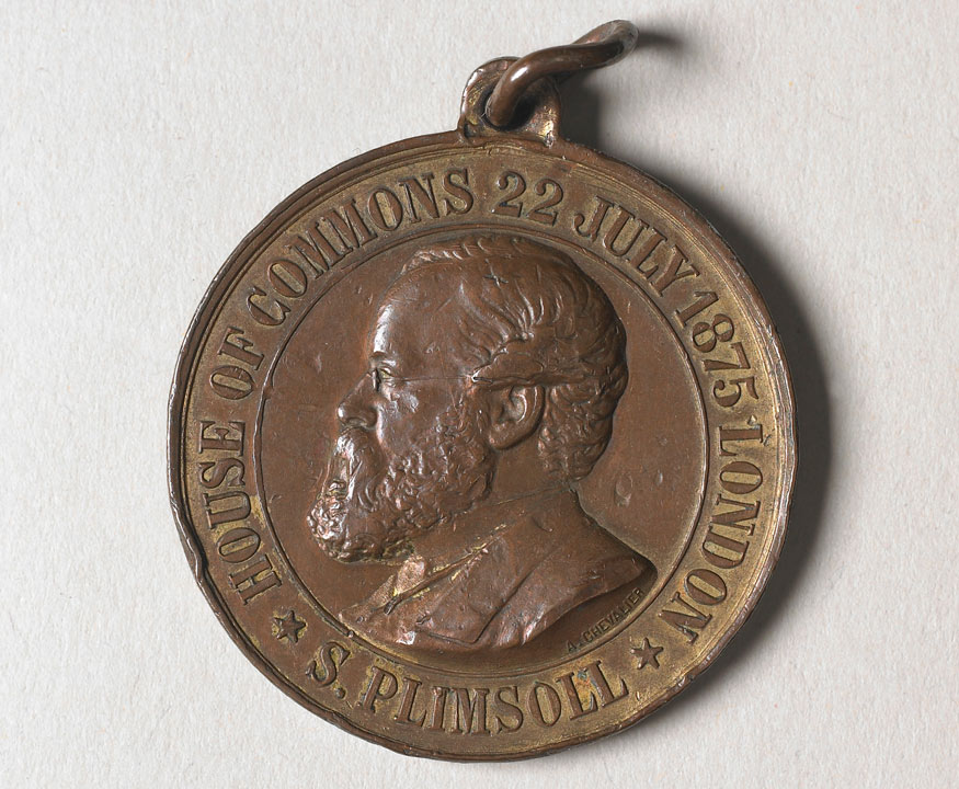 Medallion with man's head and text: S Plimsoll, House of Commons 22 July 1875 London