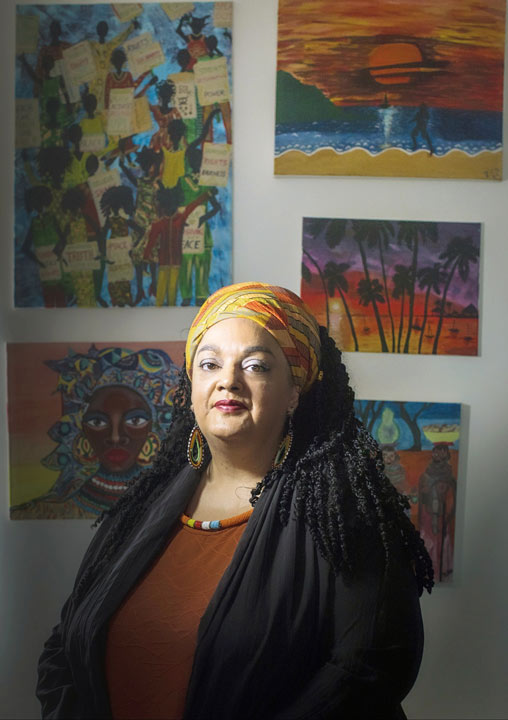 Zita Holbourne by her paintings