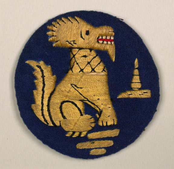 Woven badge with mythical beast