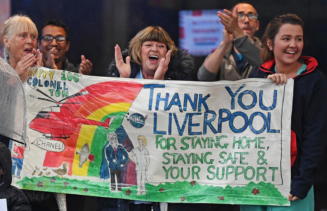 hospital staff clapping with banner with message: Thank you Liverpool for staying at home, staying safe and your support