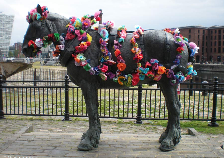 working horse sculpture covered in flowers