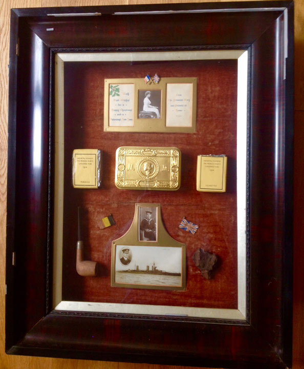 various gift items in a thick wooden frame