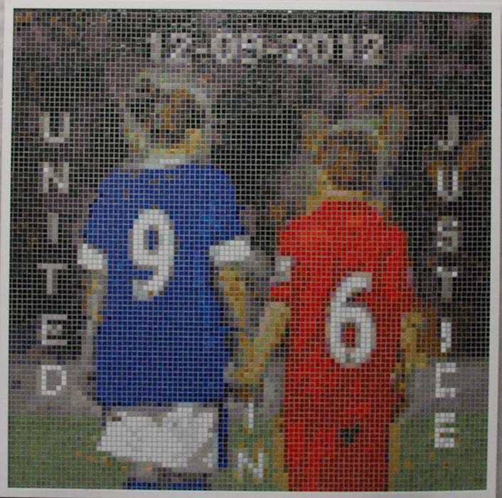 mosaic showing an Everton and a Liverpool fan holding hands